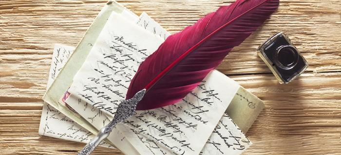 Handschrift mit einer Feder.